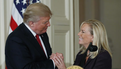 U.S. President Trump clasps the hands of his DHS nominee Nielsen at the White House in Washington