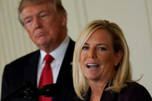 President Donald Trump listens to his then-Secretary of Homeland Security nominee Kirstjen Nielsen during a 2017 briefing in the East Room of the White House in Washington, D.C. Photo by Yuri Gripas/Reuters