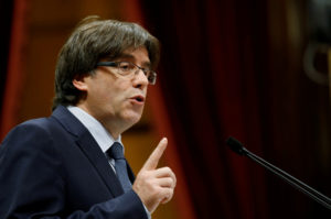 FILE PHOTO - Puigdemont speaks during a confidence vote session at Catalan Parliament in Barcelona