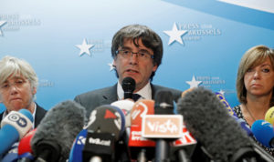 Deposed Catalan leader Carles Puigdemont and former members of the government of Catalonia Clara Ponsati and Meritxell Borras attend a news conference in Brussels, Belgium, on Oct. 31. Photo by Yves Herman/Reuters