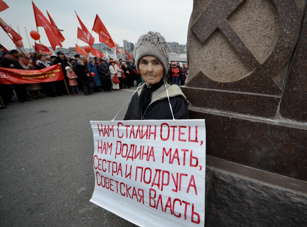 "A woman in the far eastern city of Vladivostok, Russia, holds a sign that reads: ""Stalin is our father, homeland is our mother, Soviet power is our sister and our friend."" Photo by Yuri Maltsev/Reuters"