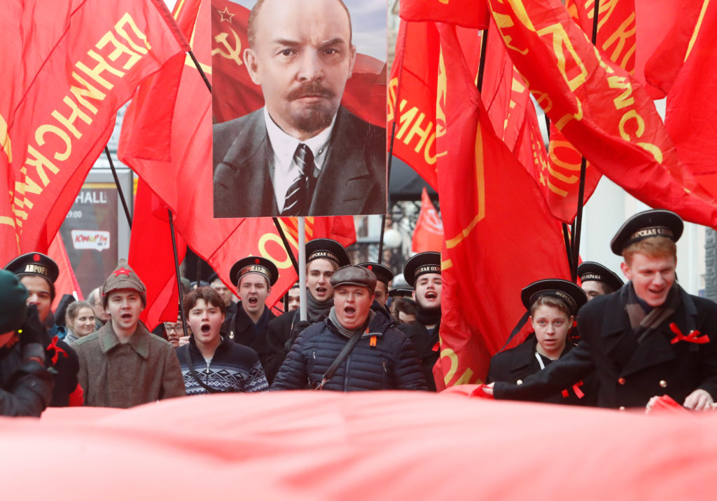 Demonstrators in Moscow carry a portrait of Soviet state founder Vladimir Lenin. Photo by Sergei Karpukhin/Reuters