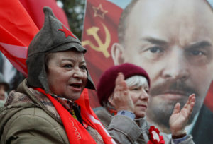 Russians attend a rally marking the centennial of the Bolshevik Revolution in central Moscow on Nov. 7. Photo by Sergei Karpukhin/Reuters