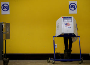 A voter fills her ballot on election day in the Park Slope section of the Brooklyn borough of New York City. Photo by Brendan McDermid/Reuters