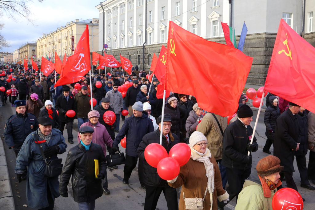 Russian Communist Party supporters march in the northern city of Petrozavodsk, Russia, on Nov. 7. Photo by Vladimir Larionov/Reuters