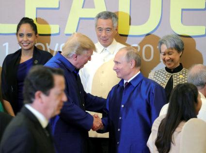 President Donald Trump and Russian President Vladimir Putin shake hands at the APEC summit in Danang, Vietnam on Nov. 10. Photo by Sputnik/Mikhail Klimentyev/Kremlin via Reuters