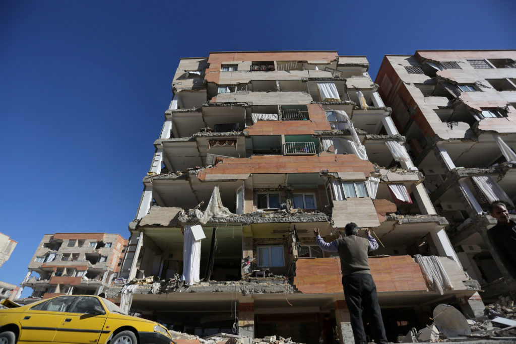 Part of an apartment building fell in Sarpol-e Zahab county in Kermanshah, Iran. Photo by Tasnim News Agency via Reuters