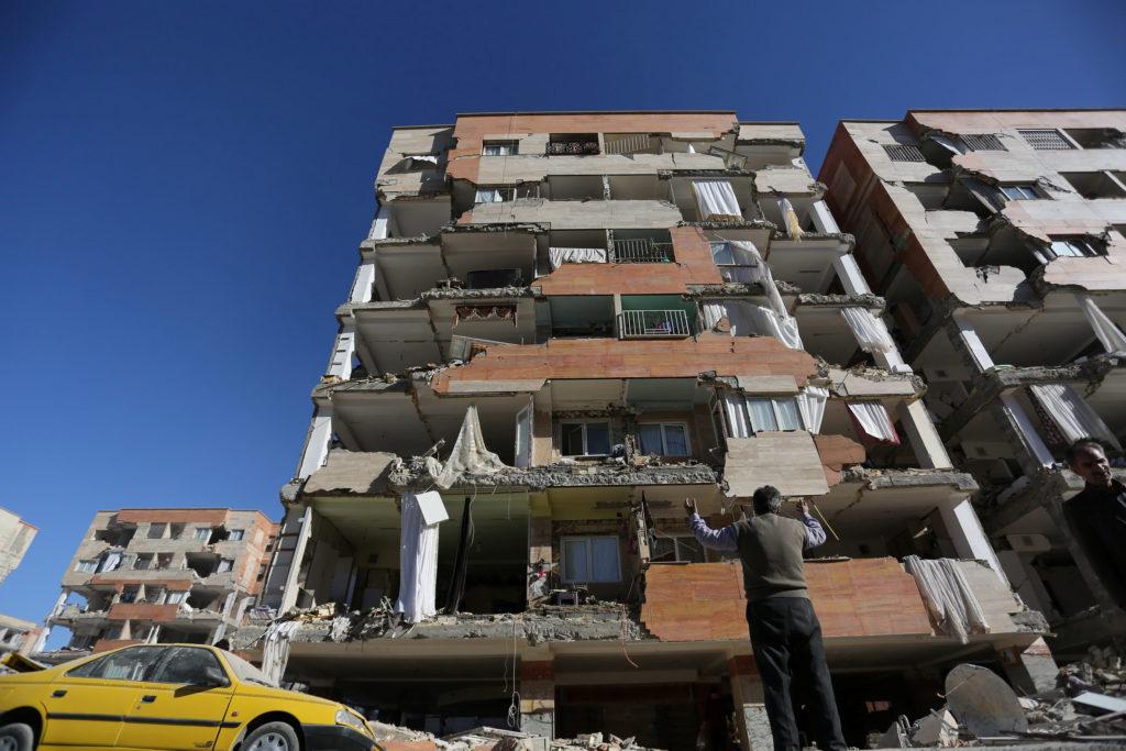 Part of an apartment building fell in Sarpol-e Zahab county in Kermanshah, Iran. Photo by Tasnim News Agency via Reuters