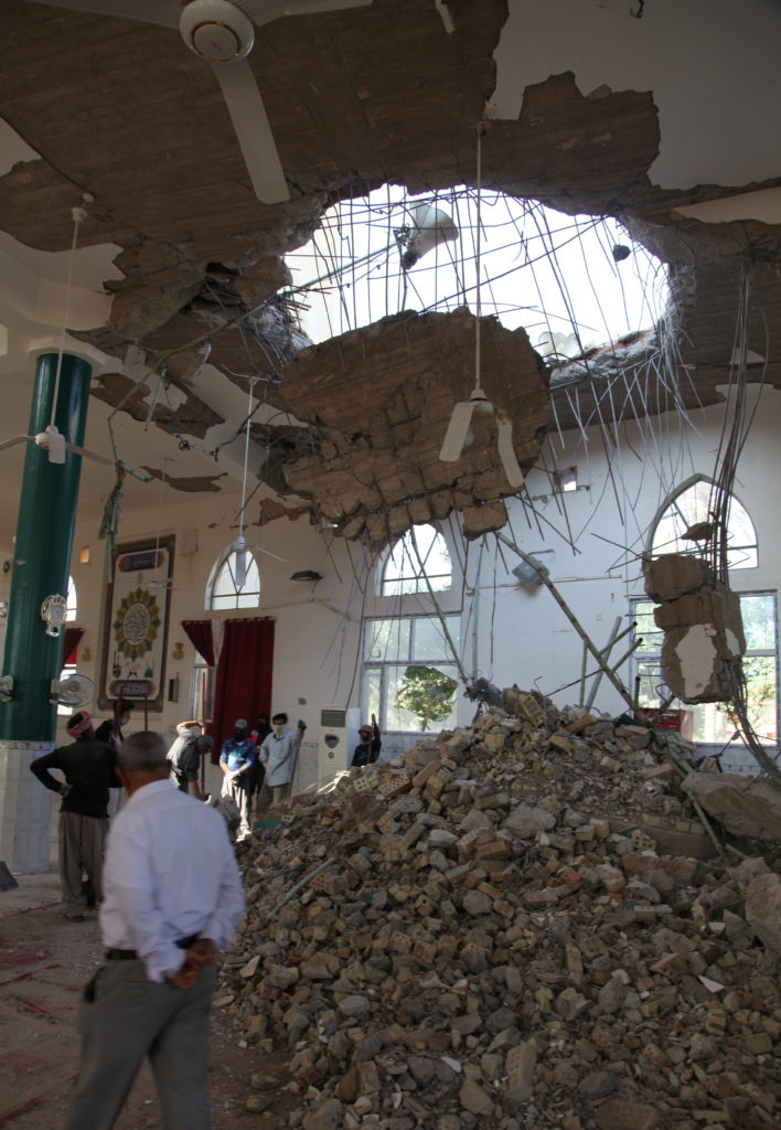 People remove rubble from a damaged mosque in Khanaqin, Iraq. Photo by a Reuters stringer