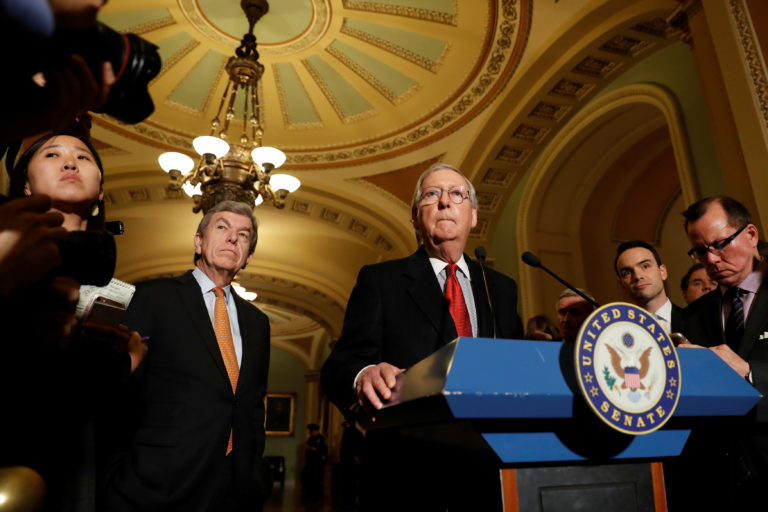Senate Majority Leader Mitch McConnell, accompanied by Sen. Roy Blunt (R-MO), speaks with reporters following the party luncheons on Capitol Hill in Washington, U.S. November 14, 2017. REUTERS/Aaron P. Bernstein - RC1DDD4565A0