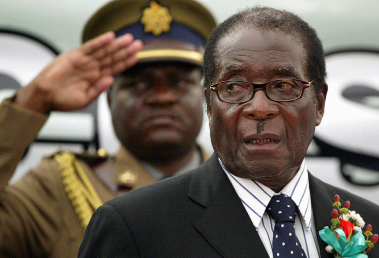 FILE PHOTO: File photo of Zimbabwe President Mugabe attending the launch of basic commodities in Harare