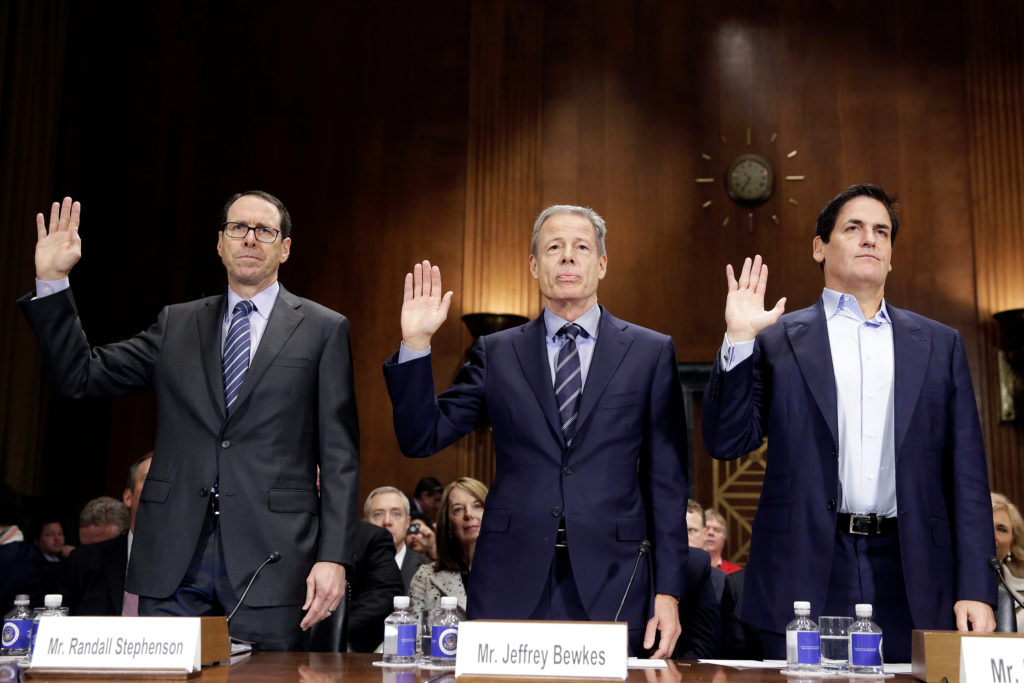Chairman and Chief Executive Officer of AT&T Randall Stephenson (L), Chairman and Chief Executive Officer of Time Warner Jeffrey Bewkes (C) and Chairman of AXS TV and owner of the Dallas Mavericks Mark Cuban are sworn in before a Senate Judiciary Committee Antitrust Subcommittee hearing on the proposed deal between AT&T and Time Warner in Washington, U.S., December 7, 2016. REUTERS/Joshua Roberts