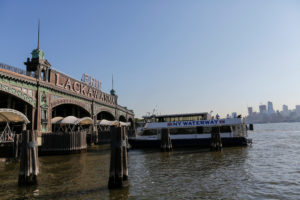 People board the ferry after arriving at the Hoboken Terminal
