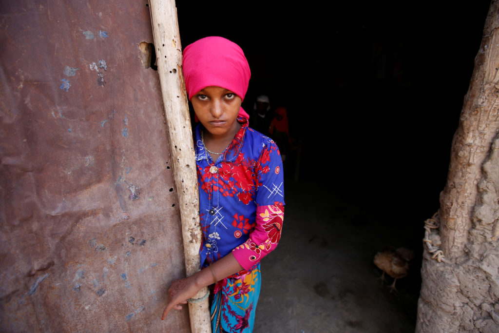 Saida Ahmad Baghili, 19, who is recovering from severe malnutrition, stands at the door of her family's hut in al-Tuhaitadistrict of the Red Sea province of Hodeidah, Yemen, October 20, 2017. REUTERS/Abduljabbar Zeyad.