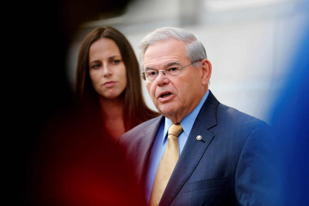 FILE PHOTO: Senator Bob Menendez speaks to journalists after arriving to face trial for federal corruption charges as his daughter Alicia Menendez looks on outside United States District Court for the District of New Jersey in Newark, New Jersey, U.S., September 6, 2017. REUTERS/Joe Penney/File Photo - RC1CBC7DE880
