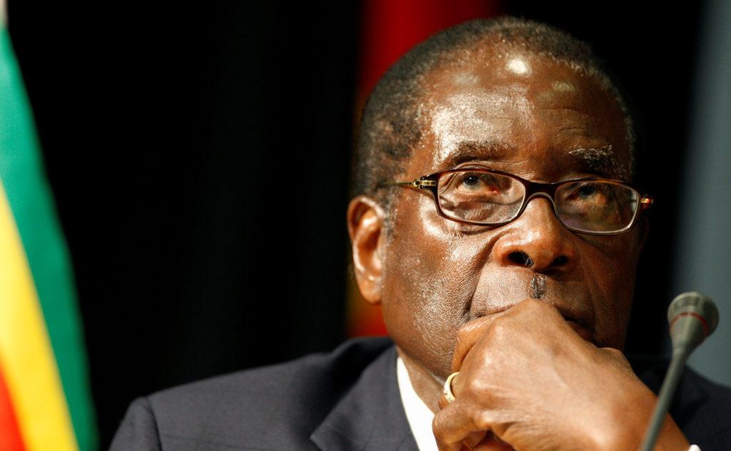FILE PHOTO - Zimbabwe's President Robert Mugabe listens at the open…
