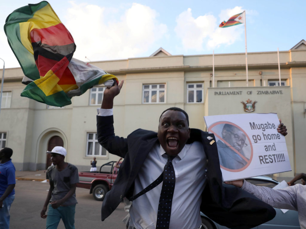 Zimbabweans celebrate after President Robert Mugabe resigns in Harare on Nov. 21. Photo by Mike Hutchings/Reuters