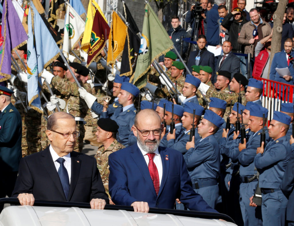 Lebanese President Michel Aoun (left) and Defense Minister Yacoub al-Sarraf take part in a military parade to celebrate the 74th anniversary of Lebanon's independence in downtown Beirut on Nov. 22. Photo by Mohamed Azakir/Reuters