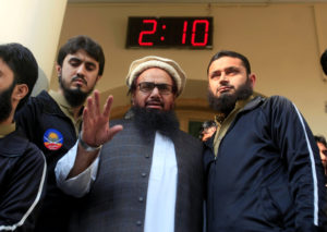 Hafiz Saeed speaks with supporters after attending Friday prayers in Lahore, Pakistan on Nov. 24. Photo by Mohsin Raza/Reuters