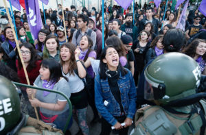 Members of feminist organizations rally against gender violence on the International Day for the Elimination of Violence Against Women, in Valparaiso