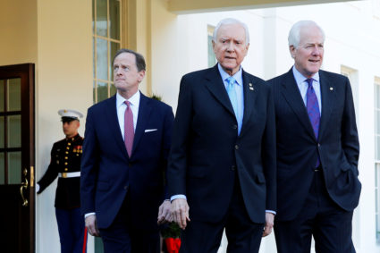 Republican members of the U.S. Senate Finance Committee, including U.S. Pat Toomey (R-PA), Senator Orrin Hatch (R-UT) and Senator John Cornyn (R-TX), walk out to speak to reporters after their meeting about proposed changes in the tax code with U.S. President Donald Trump, at the White House in Washington, U.S. November 27, 2017. REUTERS/Jonathan Ernst - RC11FFBFE400