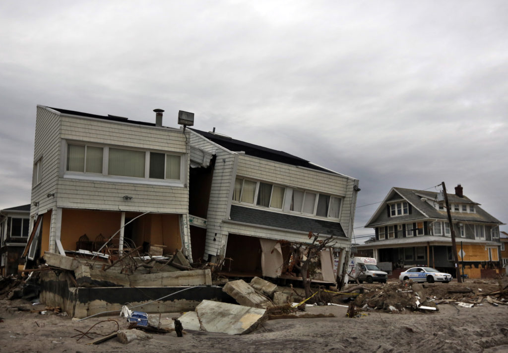 The remains of houses destroyed during Hurricane Sandy are seen in the Rockaways area of New York's borough of Queens, January 14, 2013. Congress is set to take up the Sandy Recovery Improvement Act, which would expedite the payment of disaster relief funds this week. Brendan McDermid/REUTERS