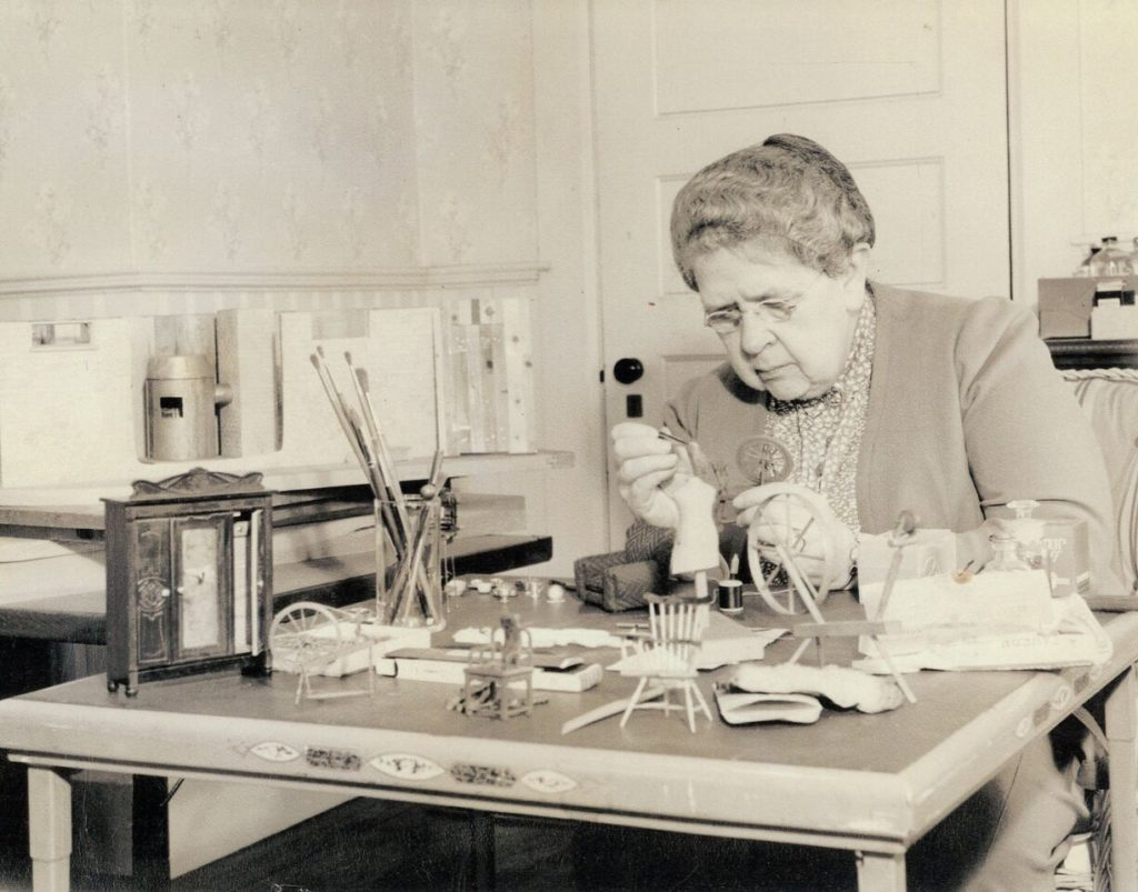 "Frances Glessner Lee, the ""godmother of forensic science,"" at work on her Nutshells."
