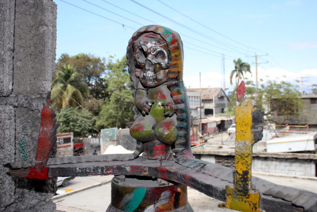 Artist Jean Herard Celeur's works are done with metal, old tires and other debris. Photo by Larisa Epatko
