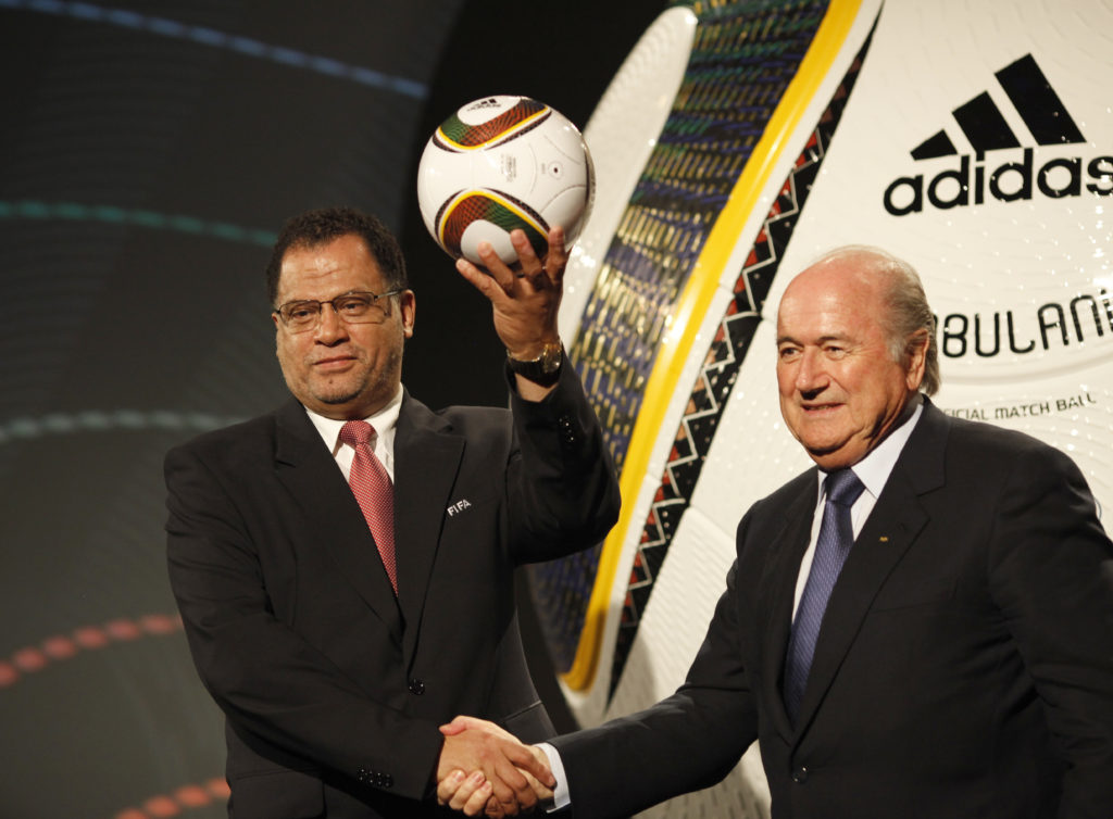 Danny Jordaan (L) CEO of the 2010 FIFA World Cup Organising Committee South Africa shakes hands with FIFA president Sepp Blatter during the launch of the official matchball for the 2010 World Cup, before the draw for the finals, in Cape Town December 4, 2009. The month-long soccer tournament begins on June 11 next year in South Africa. REUTERS/Mike Hutchings (SOUTH AFRICA) - LF1E5C417PJ01
