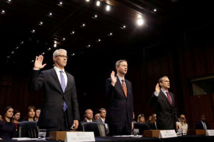 (L-R) Colin Stretch, general counsel for Facebook, Sean Edgett, acting general counsel for Twitter, and Richard Salgado, director of law enforcement and information security at Google, are sworn in prior to testifying before the Senate Intelligence Committee to answer questions related to Russian use of social media to influence U.S. elections, on Capitol Hill in Washington, U.S., November 1, 2017. REUTERS/Joshua Roberts TPX IMAGES OF THE DAY - RC17A80EE120