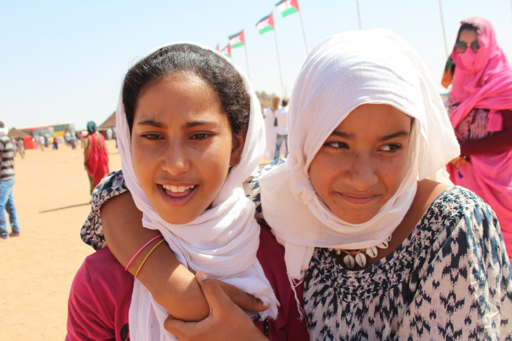 Two friends roam the Dakhla refugee camp in Algeria. Photo by Larisa Epatko
