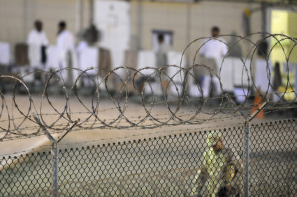 """A Navy guard patrols Camp Delta?s detainee recreation yard during the early morning at Guantanamo Bay naval base in a July 7, 2010 file photo provided by the US Army. President Barack Obama urged lawmakers on Tuesday to give his plan to close the U.S. military prison at Guantanamo Bay, Cuba, a """"fair hearing"""" and said he did not want to pass the issue to his successor when he leaves the White House next year. REUTERS/U.S. Air Force Tech. Sgt. Michael R. Holzworth/US Army/Handout via Reuters FOR EDITORIAL USE ONLY. NOT FOR SALE FOR MARKETING OR ADVERTISING CAMPAIGNS. THIS IMAGE HAS BEEN SUPPLIED BY A THIRD PARTY. IT IS DISTRIBUTED, EXACTLY AS RECEIVED BY REUTERS, AS A SERVICE TO CLIENTS - TM3EC2N0XDD01"""