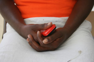 The hands of a rape survivor in Haiti. Photo by Larisa Epatko