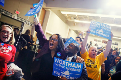 Supporters of Democratic gubernatorial candidate Ralph Northam begin to celebrate as results start to come in at Northam's election night rally on the campus of George Mason University in Fairfax, Virginia, November 7, 2017. REUTERS/Aaron P. Bernstein - HP1EDB805EE05