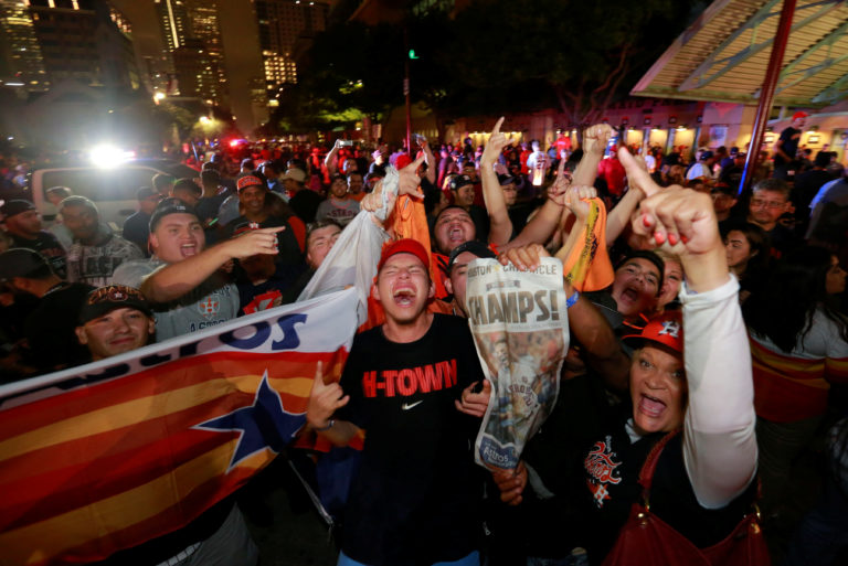 Houston Astros fans celebrate after winning the World Series against the Los Angeles Dodgers outside Minute Maid Park in Houston, Texas, U.S. November 1, 2017. REUTERS/Richard Carson