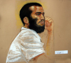 In this photo of a sketch by courtroom artist Janet Hamlin, reviewed by a U.S. Department of Defense official, Canadian defendant Omar Khadr attends a hearing in the courthouse for the U.S. military war crimes commission at the Camp Justice compound on Guantanamo Bay U.S. Naval Base in Cuba on April 28, 2010. Photo by Janet Hamlin/AFP/Getty Images