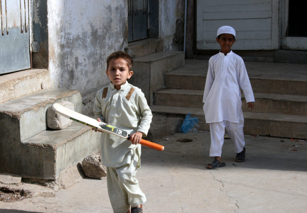 Boys play cricket at Jamia Binoria Madrassa in downtown Karachi. They learn about the Quran, math, social science and languages. Photo by Larisa Epatko