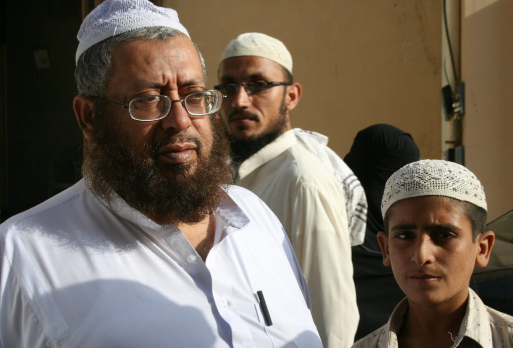 Principal Mufti Naim (left) says most madrassas in Pakistan have nothing to do with extremism. Photo by Larisa Epatko