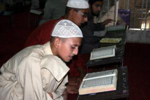 Boys at the Jamia Binoria Madrassa in Karachi recite the Quran. Photo by Larisa Epatko