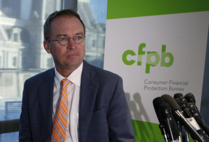 Office of Management and Budget (OMB) Director Mick Mulvaney arrives to speak to the media at the U.S. Consumer Financial Protection Bureau (CFPB), where he began work earlier in the day after being named acting director by U.S. President Donald Trump in Washington November 27, 2017. REUTERS/Joshua Roberts - HP1EDBR1N400F