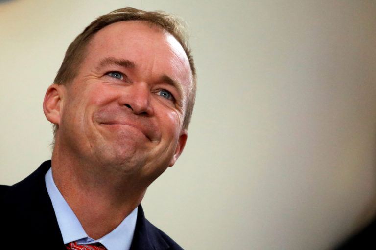 FILE PHOTO: Office of Management and Budget Director Mick Mulvaney attends the daily briefing at the White House in Washington, U.S., July 20, 2017. REUTERS/Carlos Barria/File Photo - RC18B3CC41F0