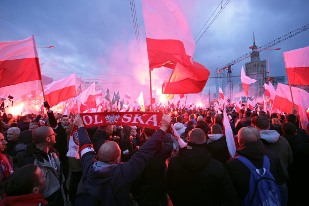 Protesters carry Polish flags and National Radical Camp flags during a rally, organised by far-right, nationalist groups, to mark 99th anniversary of Polish independence in Warsaw, Poland November 11, 2017. Agencja Gazeta/Adam Stepien via REUTERS ATTENTION EDITORS - THIS IMAGE WAS PROVIDED BY A THIRD PARTY. POLAND OUT. NO COMMERCIAL OR EDITORIAL SALES IN POLAND. - RC13189B52F0