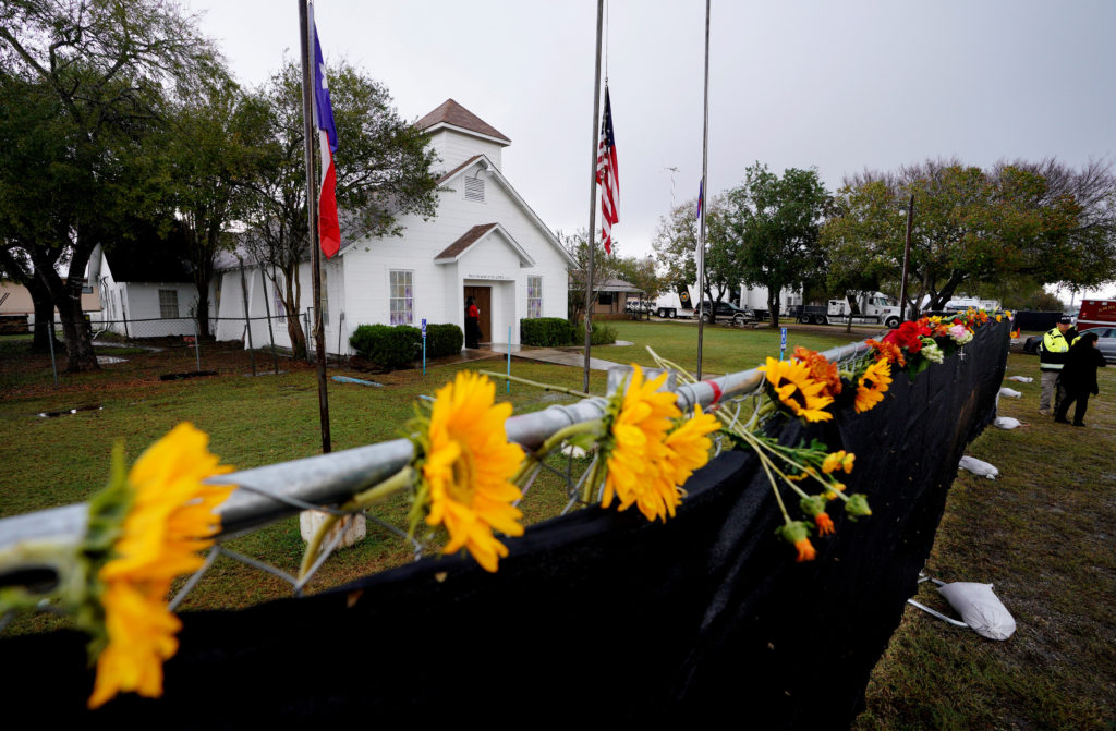 Flowers decorate the fence around the First Baptist Church of Sutherland Springs where 26 people were killed one week ago, as the church opens to the public as a memorial to those killed, in Sutherland Springs, Texas, U.S. November 12, 2017. REUTERS/Rick Wilking - RC1290D25580