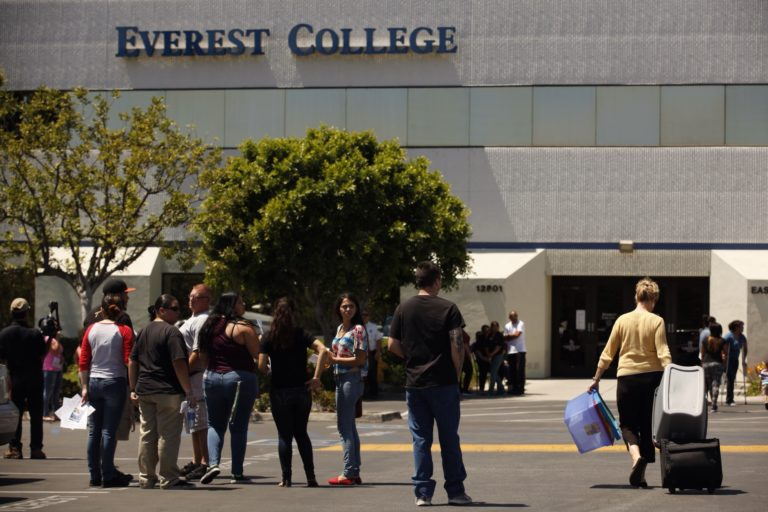Students gather as teachers came to collect their belongings at Everest College in City of Industry, one of the Corinthian Colleges that closed in 2015. Photo by Al Seib/Los Angeles Times via Getty Images