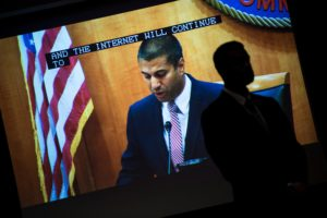 FCC Chairman Ajit Pai is seen on a screen before a vote to repeal Net Neutrality protections during a hearing at the Federal Communications Commission December 14, 2017 in Washington, DC. / AFP PHOTO / Brendan Smialowski (Photo credit should read BRENDAN SMIALOWSKI/AFP/Getty Images)