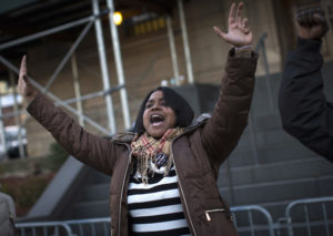 Erica Garner, the daughter of Eric Garner leads a chant at a protest and candlelight vigil outside the 120th police precinct in the Staten Island borough of New York City