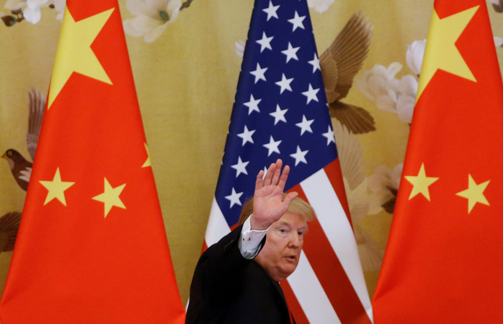 U.S. President Donald Trump waves during joint statements with China's President Xi Jinping at the Great Hall of the People in Beijing, China, November 9, 2017. REUTERS/Thomas Peter - RC1839C10750