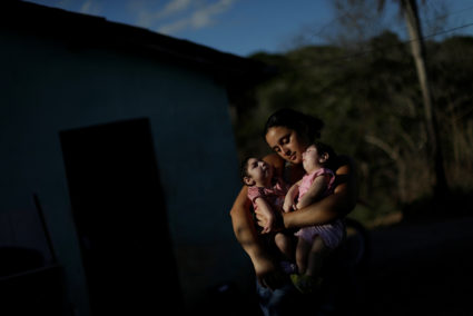 Raquel Barbosa poses with her twin daughters Heloa and Heloisa, both 10 months old and both born with microcephaly, in Areia, Paraiba state, Brazil, February 8, 2017. Picture taken February 8, 2017. REUTERS/Ueslei Marcelino