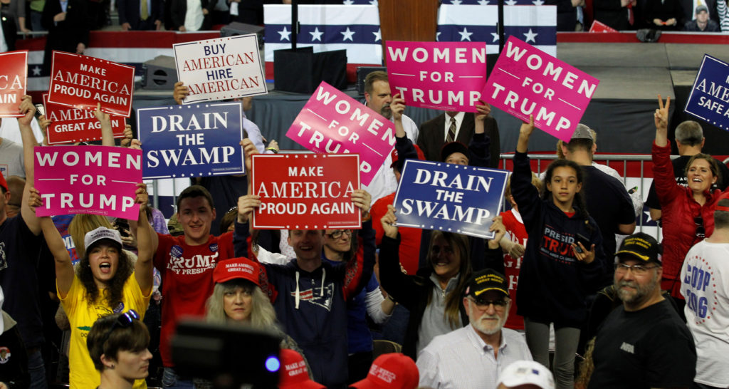 Fans of U.S. President Donald Trump cheer for their president as they wait for his arrival for a rally in Louisville, Kentucky, March 20, 2017. REUTERS/John Sommers II