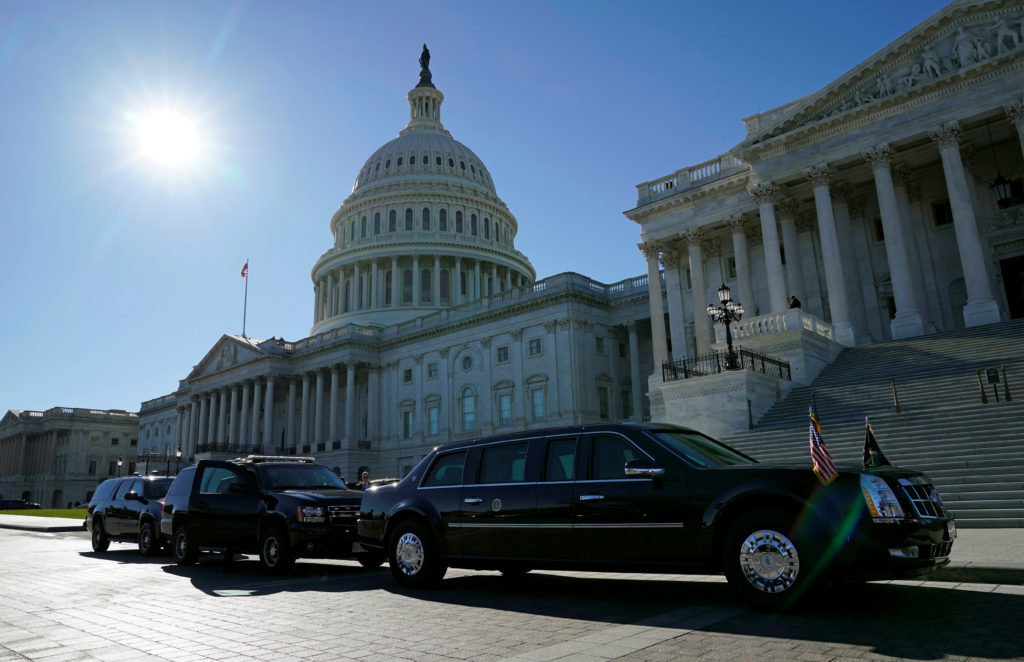 FILE PHOTO: The Presidential motorcade awaits the departure of U.S. President Donald Trump from the U.S. Capitol in Washington, DC, U.S. on November 28, 2017. REUTERS/Kevin Lamarque/File Photo - RC1D221C4C20